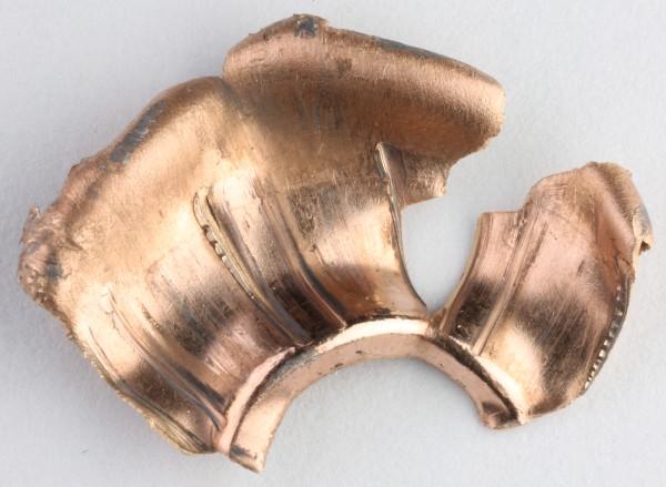 Osa 45acp-kaliiperin luodin kuparivaipasta rihlajälkineen